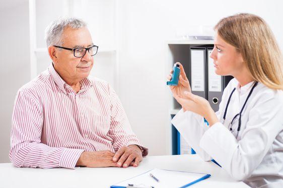 Doctor diagnosing asthma
