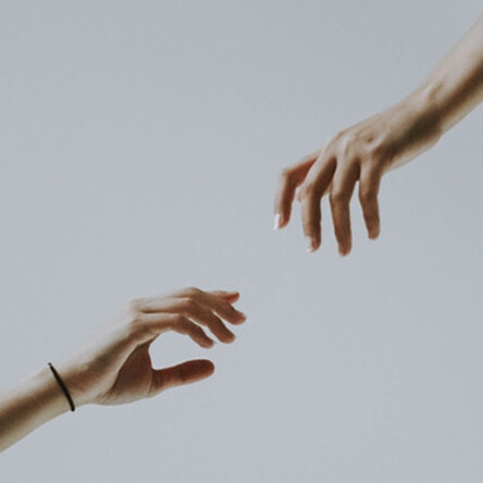 Two hands reaching out for support
