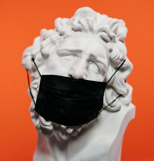 Statue wearing a face mask